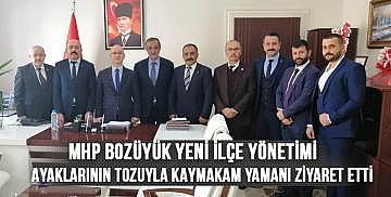 MHP Bozüyük yeni ilçe yönetimi ayaklarının tozuyla kaymakam Yamanı ziyaret etti